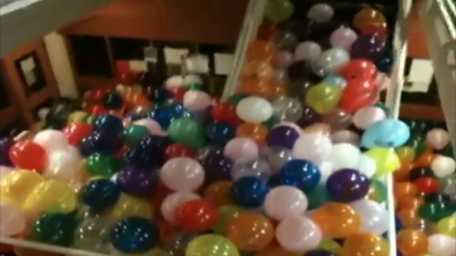 VIDEO:  May, 2012: Seniors at a Massachusetts high school used 3,300 balloons to fill a school staircase.