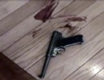 VIDEO: Police footage shows gun atop stairs, aftermath of husbands bloody beating.