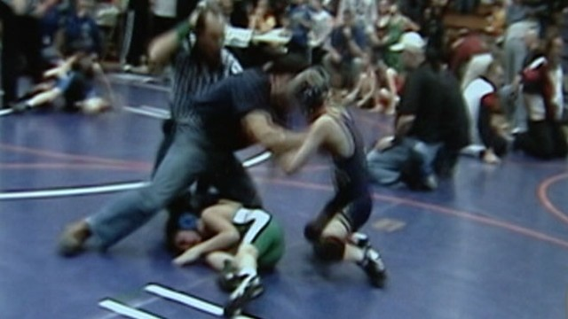 VIDEO:  2007: Man thinks son is getting hurt, tosses 10-year-old opponent out of match.