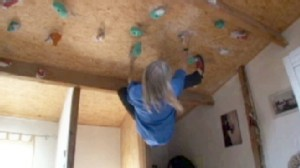 VIDEO: Building climber Alain Robert hangs from ceiling at home to stay in super shape.