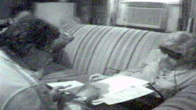VIDEO: Footage from authorities shows man in wig, dress in meeting with investigators.