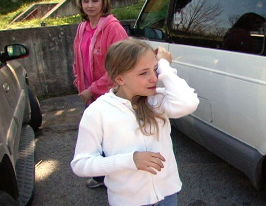 Photo: Erica cries after social services forces her mother, Mona, into rehab.