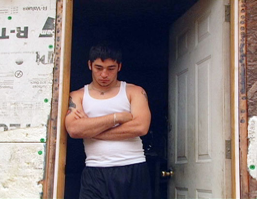 Photo: Shawn in the doorway of his family's trailer in Flat Gap, Ky.