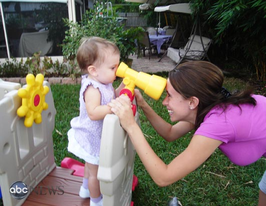 Caylee and Casey Anthony playing in their backyard in the fall of 2006.
