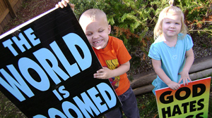 PHOTO Boaz Drain, a seven-year-old from Topeka, Kansas and his six-year-old sister Faith belong to the Westboro Baptist Church, and often join their parents in the daily task of picketing the streets.