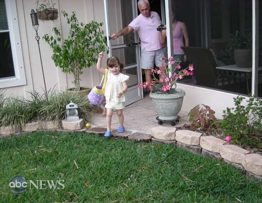 Caylee Anthony looking for Easter eggs with her grandfather George Anthony.