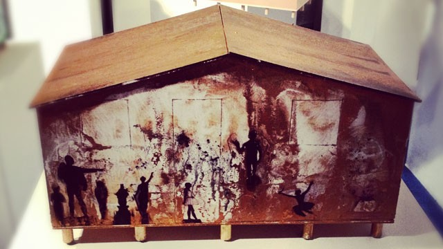 A small-scale replica of a house intervened by the Cuban artist Glexis Novoa for the non-profit organization &quot;Techo&quot;. They build houses in areas of extreme poverty in Latin America.