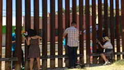 "Three young undocumented immigrants get to hug their mothers for the first time in years through the border fence thanks to a reunion organized by ""United We Dream""."