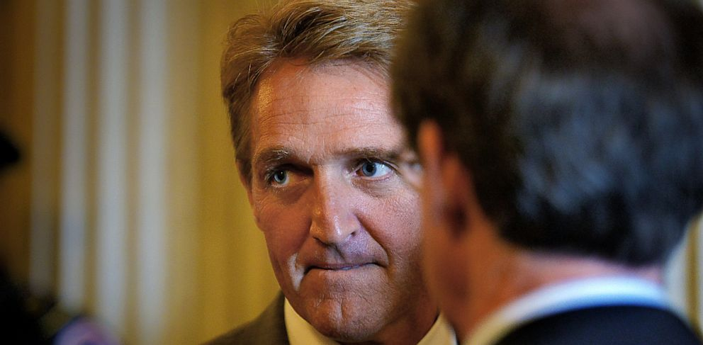 PHOTO: Senator Jeff Flake (R-Ariz.) ponders a reporters question outside of the Senate chamber after a vote on June, 13, 2013 in Washington, D.C.