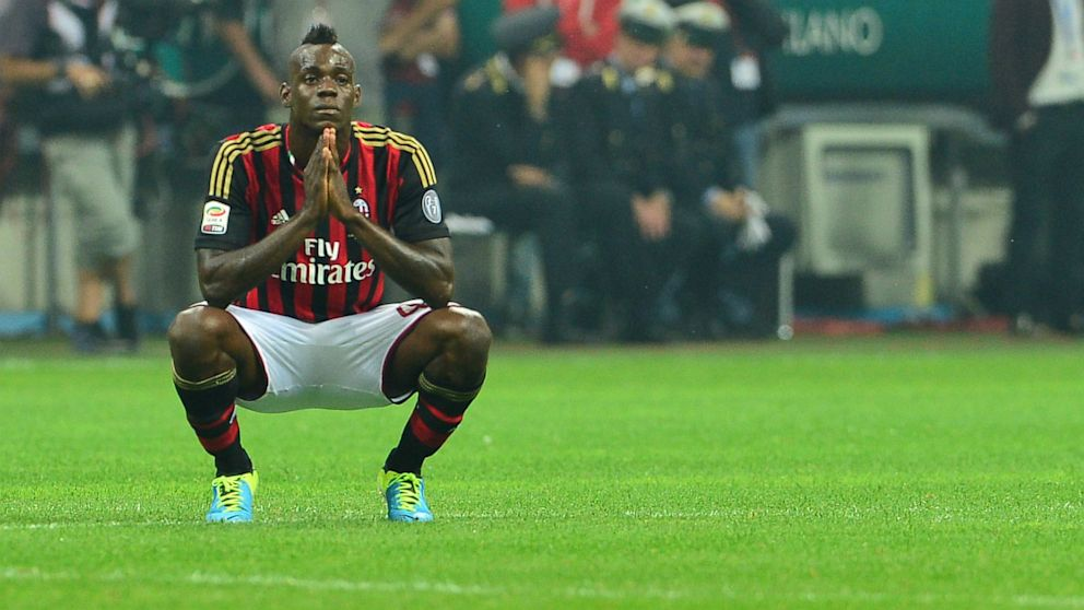 PHOTO: AC Milans forwards Mario Balotelli reacts after missing a penalty shot during the Serie A football match AC Milan vs Naples, on September 22, 2013, at the San Siro stadium in Milan.