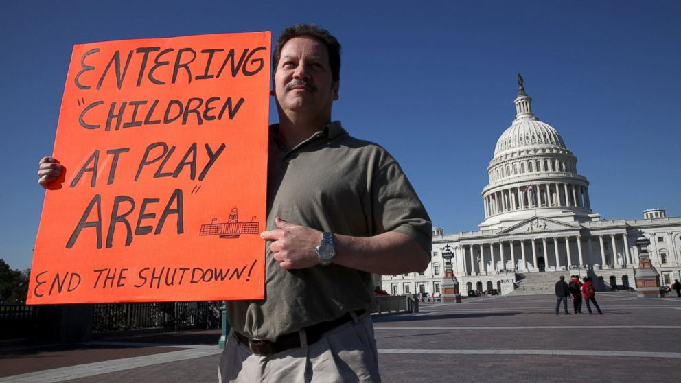 PHOTO: Matthew Murguia, a 53 year old furloughed federal employee, walks around the United States Capitol building on the fifteenth day of the U.S. government shutdown in Washington D.C., U.S., on Tuesday, Oct. 15, 2013.