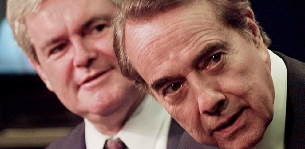 PHOTO: Then-Republican presidential candidate Bob Dole (R)and Speaker of the House Newt Gingrich (L) look around the corner to see who is in the room before starting a press conference at the U.S, Capitol.