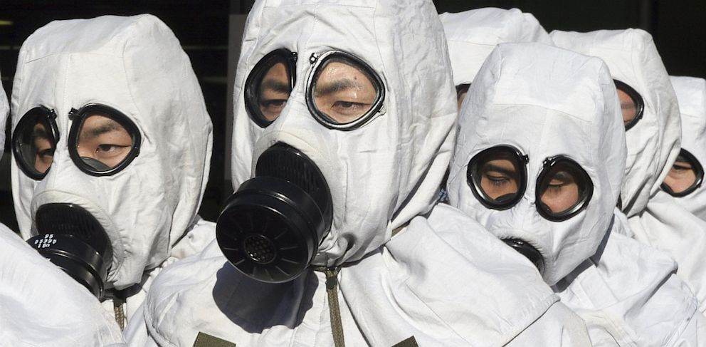 Men in chemical protection suits participate in a joint anti-terrorism drill conducted by Japan Ground Self-Defense Force on November 17, 2005.