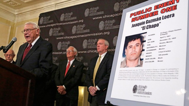 "PHOTO: Art Bilek, Executive Vice President of the Chicago Crime Commission, left, announces that Joaquin ""El Chapo'' Guzman, a drug kingpin in Mexico, is Chicago's Public Enemy No. 1. during a news conference Thursday, Feb. 14 in Chicago."