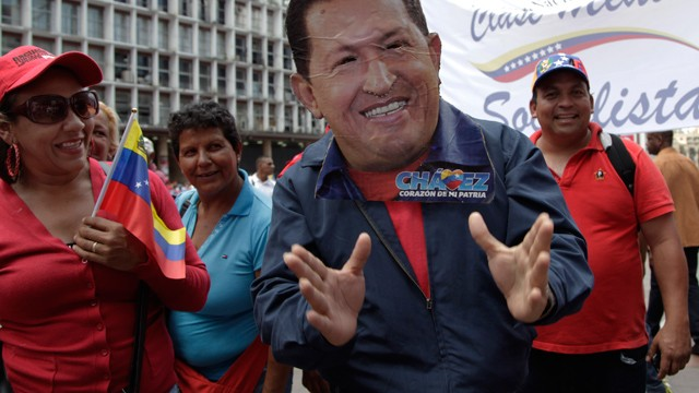 PHOTO: A man wearing a handcrafted mask depicting the face of Venezuela's President Hugo Chavez attends an event commemorating the violent street protests of 1989 known as the