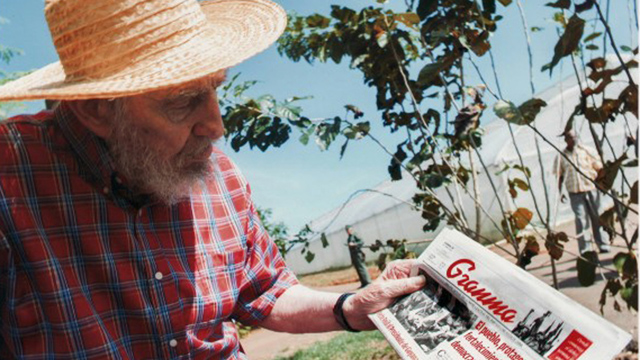 PHOTO: Fidel Castro holding a copy Fridays Oct. 19, 2012 edition of the newspaper Granma in Habana, Cuba.