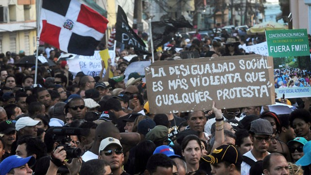 PHOTO:&nbsp;Dominicans attend a demonstration against the fiscal reform in Santo Domingo, Dominican Republic, Sunday, Nov. 11, 2012. The measure will increase the general sales tax to 18 percent from 16 percent, will raise the price of gasoline and impose taxe