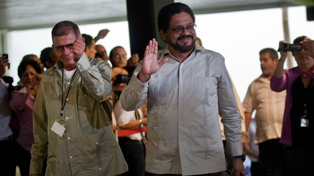 PHOTO:&nbsp;Ivan Marquez, right, and Ricardo Tellez, members of the negotiation team for Colombia's Revolutionary Armed Forces of Colombia, or FARC, wave as they arrive for peace talks in Havana, Cuba, Monday, Nov. 19.