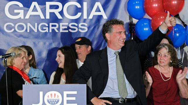 PHOTO: Democrat Joe Garcia celebrates his victory over Republican Congressman David Rivera