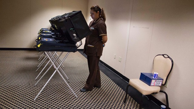 PHOTO: Liliana Perez, casts her ballot at an early voting polling place behind The Mirage Hotel Casino, Saturday, Oct. 20, 2012, in Las Vegas.
