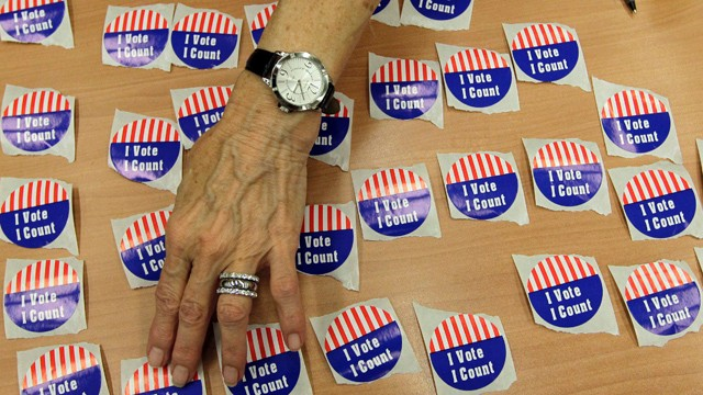 PHOTO:&nbsp;An election judge arranges &quot;I Vote, I Count&quot; stickers on a table in the Marion County Clerks office as voterscast early ballots in Indianapolis, Monday, Oct. 22, 2012.