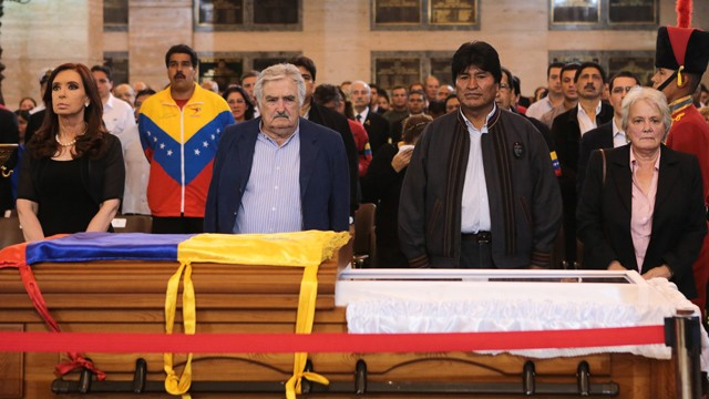 PHOTO:&nbsp;Leftist allies of President Hugo Chavez stand by his coffin in this photo taken in Caracas on March 6, 2013.