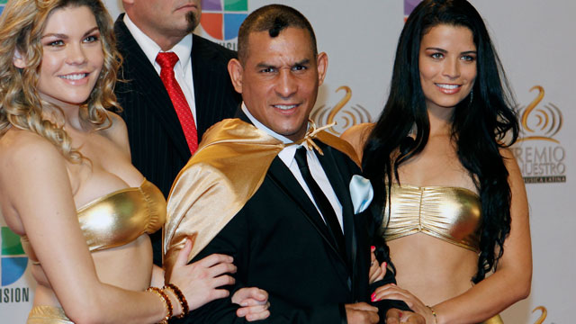 """PHOTO:In this Feb. 16, 2012 file photo former boxing champion Hector """"Macho"""" Camacho,poses for photographers at his arrival to the Premio Lo Nuestro Music Awards in Miami."""