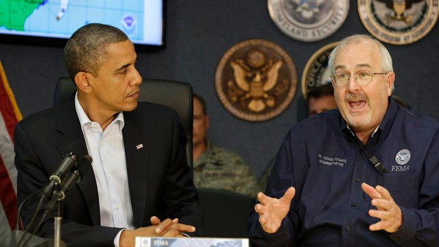 PHOTO:&nbsp;President Barack Obama, left, listens as Federal Emergency Management Agency administrator Craig Fugate speaks to the media at FEMA Headquarters in Washington, on Sunday, Oct. 28, 2012.