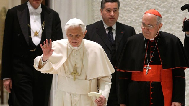 PHOTO:  Pope Benedict XVI delivers his blessing as he arrives for an audience the with Roman clergy.
