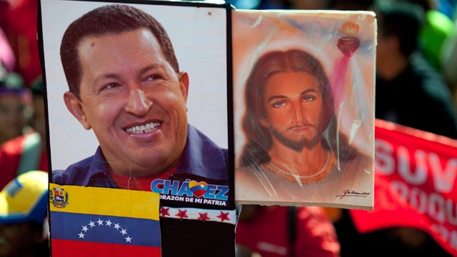 PHOTO: A picture of Venezuela's President Hugo Chavez is held up alongside an image of Jesus Christ at a rally by Chavez supporters in Caracas, Venezuela, Thursday, Jan. 10.
