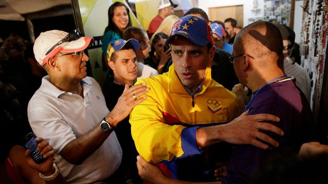 PHOTO:&nbsp;Venezuelan opposition candidate Henrique Capriles greets supporters who congratulate him for his victory in Miranda State on Sunday. Capriles was one of just three opposition candidates who were not defeated by Chavez allies on Sunday.
