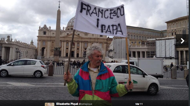 PHOTO: A man holds a sign in the Vatican on March 11th. Two days later the name of the new Pope was revealed and this man was right!
