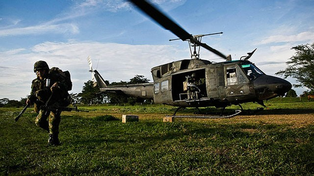 PHOTO: A Colombian soldier lands in a remote area of Colombia´s Meta province, during an operation against the FARC guerrillas.  The Colombian government launches peace talks with the rebel group on Thursday.