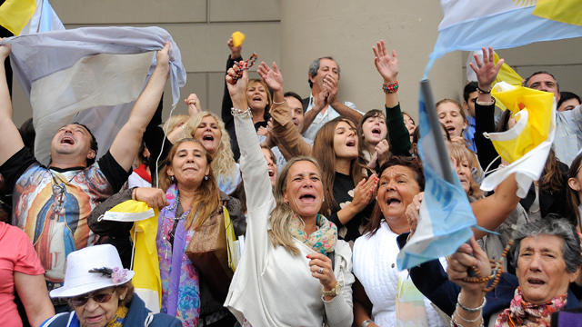 PHOTO: People celebrate in front of Buenos Aires Cathedral after the election of Cardinal Jorge Mario Bergoglio as the new Pope Francis I on March 13, 2013 in Buenos Aires, Argentina. Bergoglio is the first ever Latin American Pope
