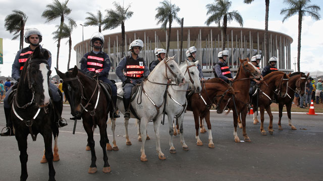 PHOTO: Security officers guard the National Stadium in Brasilia, on June 15, 2013. Large spending on world cup stadiums like this one, has sparked numerous protests in Brazil. (Dean Mouhtaropoulos/Getty Images)