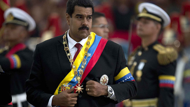 PHOTO: During his inauguration on Friday, Nicolas Maduro wore a presidential sash and an armband with the colors of Venezuelas flag. Socialists in Venezuela, also use this armband in political events.
