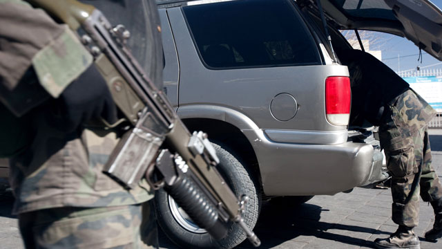 PHOTO:Soldiers search a vehicle at the Juarez Avenue border crossing into the USA on January 14, 2009 in Ciudad Juarez, Mexico. Critics of immigration reform say that new laws will make it easier for Mexican cartels to operate in the U.S.