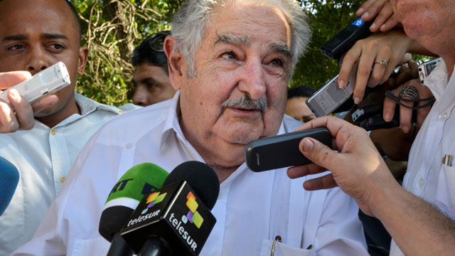 PHOTO:Uruguayan President Jose Mujica speaks with reporters during a visit to Cuba. He recently defended his drug policies on CNN saying that marijuana legalization is necessary, but that love is all you really need.