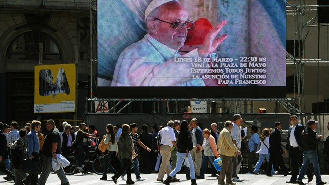 PHOTO: A screen in Buenos Aires, Argentina invites people to gather in the Plaza de Mayo to watch the Pope's inauguration ceremony. Catholics around the world expect different things from the new Pope.