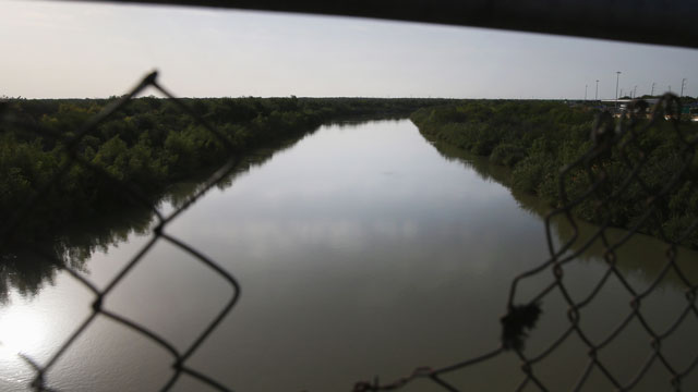 PHOTO: The Rio Grande River forms the border between the United States (L), and Mexico on April 11, 2013 in Hidalgo, Texas.