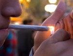 PHOTO: A young man lights a marijuana cigarette during a demonstration demanding a new law on cannabis in Montevideo on May 8, 2013.