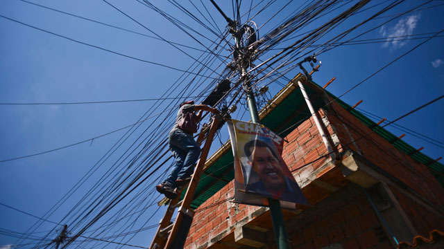 PHOTO: A technician services electrical wires in the 23 de Enero neighborhood, a stronghold of support for President Hugo Chavez, in Caracas, Venezuela, on Wednesday, Jan. 16, 2013.