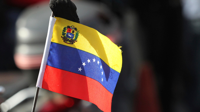 PHOTO:View of a flag during the march of the supporters of President Hugo Chavez through the streets of Caracas to the military academy on March 06, 2013 in Caracas, Venezuela. With Chavez gone a new generation of leaders must emerge in Venezuela.
