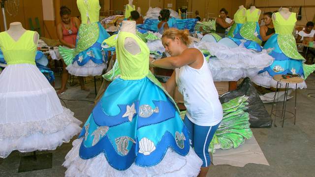 PHOTO: Women put the finishing touches on costumes for the upcoming Carnival