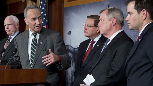 US Senator Chuck Schumer (2nd L), a Democrat from New York, speaks alongside (L-R) John McCain (R-AZ), Robert Menendez (D-NJ),Dick Durbin (D-IL) and Marco Rubio (R-FL)