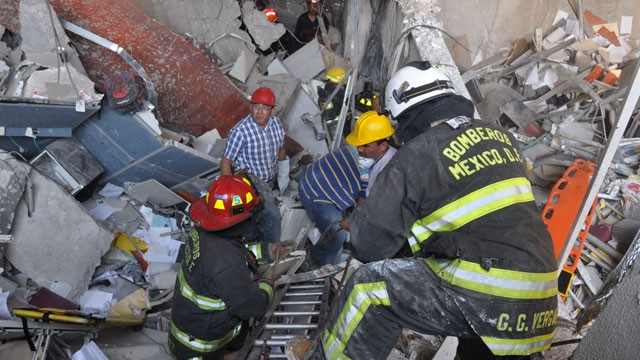 PHOTO:  Firefighters belonging to the Tacubaya sector and workers dig for survivors after an explosion at an adjacent building to the executive tower of Mexico's state-owned oil company PEMEX, in Mexico City.
