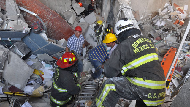 PHOTO: Firefighters belonging to the Tacubaya sector and workers dig for survivors after an explosion at an adjacent building to the executive tower of Mexicos state-owned oil company PEMEX, in Mexico City.