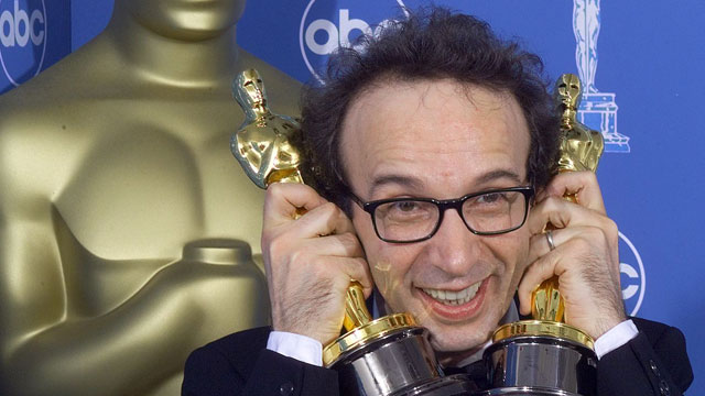 PHOTO:  Roberto Benigni, poses for photographers.