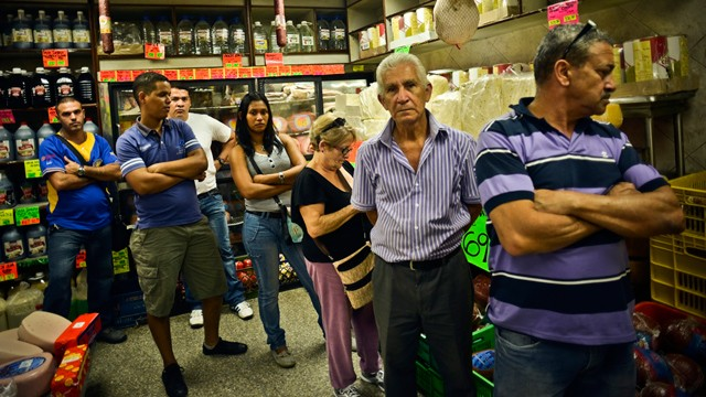 PHOTO:&nbsp;Shoppers waited in line to buy food at a private sector grocery store in the Quinta Crespo market in central Caracas, Venezuela, on Monday, Jan. 14, 2013.