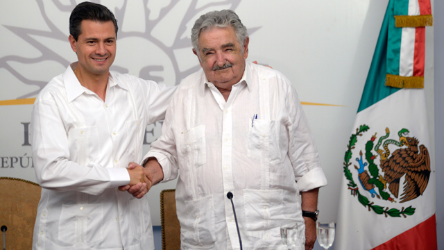 "PHOTO: Uruguayan President Jose Mujica shakes hands with Mexican President Enrique Peña Nieto, during a press conference in Montevideo on Monday, Jan. 28. Mujica is known for his austere ways, and has been nicknamed ""the world´s poorest president."""
